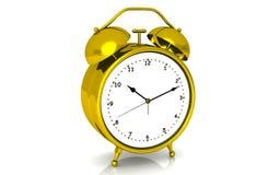 Reloj de alarma del oro Foto de archivo libre de regalías