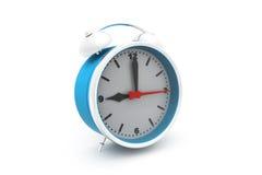 Reloj de alarma en el fondo blanco Fotografía de archivo