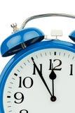 Reloj de alarma en el fondo blanco Fotos de archivo