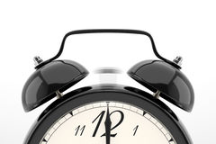 Reloj de alarma en el fondo blanco Imagen de archivo