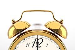 Reloj de alarma en el fondo blanco Imágenes de archivo libres de regalías