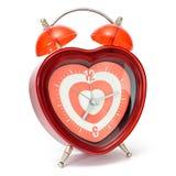 Reloj de alarma en forma de corazón Imagen de archivo