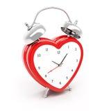 Reloj de alarma en forma de corazón Imagenes de archivo