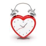 Reloj de alarma en forma de corazón Fotos de archivo libres de regalías