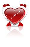 Reloj de alarma en la dimensión de una variable del amor Foto de archivo