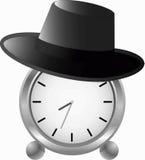 Reloj de alarma en sombrero Fotos de archivo