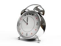 Reloj de alarma metálico aislado en el fondo blanco Imagenes de archivo