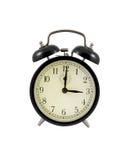Reloj de alarma retro que muestra tres horas Imágenes de archivo libres de regalías
