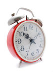 Reloj de alarma rojo Imagen de archivo
