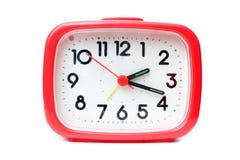 Reloj de alarma rojo Imagen de archivo libre de regalías