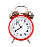 Reloj de alarma rojo Foto de archivo libre de regalías