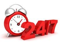 Reloj de alarma rojo con los números 24 y 7. Fotos de archivo