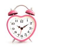 Reloj de alarma rosado Imágenes de archivo libres de regalías