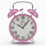 Reloj de alarma rosado Fotos de archivo libres de regalías