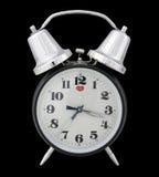 Reloj de alarma tradicional (fondo negro) Imagen de archivo