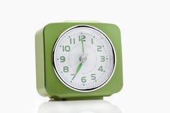 Reloj de alarma verde Foto de archivo libre de regalías
