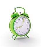 Reloj de alarma verde Imagenes de archivo