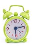Reloj de alarma verde Imagen de archivo libre de regalías