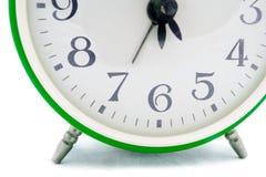 Reloj de alarma verde Fotos de archivo