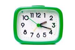 Reloj de alarma verde Fotos de archivo libres de regalías