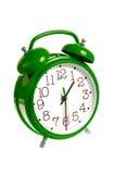 Reloj de alarma verde aislado Imagenes de archivo