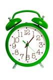 Reloj de alarma verde aislado Foto de archivo libre de regalías