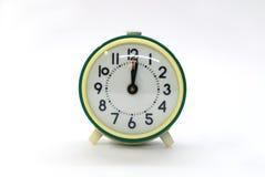 Reloj de alarma verde viejo Foto de archivo libre de regalías