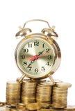 Reloj de alarma y dinero foto de archivo libre de regalías