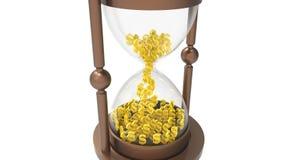 Reloj de arena con los dólares Fotos de archivo