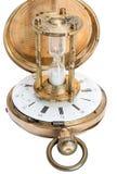 Reloj de arena con un reloj de bolsillo Fotos de archivo libres de regalías