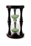 Reloj de arena de madera con la arena verde. Imagen de archivo libre de regalías