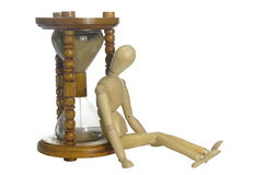 Reloj de arena y maniquí viejos Fotografía de archivo