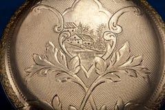 Reloj de bolsillo antiguo del oro--Macro Foto de archivo