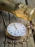 Reloj de bolsillo con la botella del champán Imagen de archivo libre de regalías