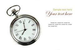 Reloj de bolsillo en el fondo blanco. Foto de archivo