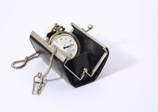Reloj de bolsillo en el monedero Imágenes de archivo libres de regalías