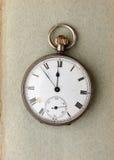 Reloj de bolsillo en el papel Imagen de archivo