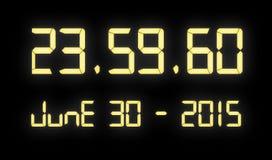 Reloj de Digitaces con 60 segundos en la medianoche Imágenes de archivo libres de regalías