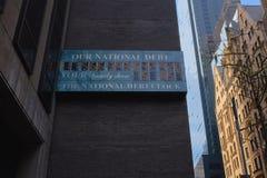 Reloj de la deuda nacional Fotos de archivo libres de regalías