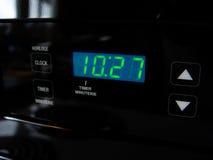 Reloj de la estufa de Digitaces imagen de archivo