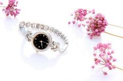 Reloj de la señora con algunas flores Imágenes de archivo libres de regalías