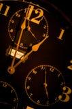 Reloj de la vendimia con las caras del mulitple imagen de archivo libre de regalías