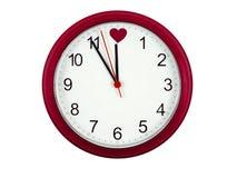 Reloj de las tarjetas del día de San Valentín fotos de archivo