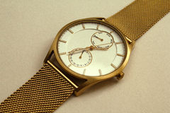 Reloj de oro Imagenes de archivo