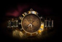 Reloj de oro fotografía de archivo