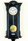 Reloj de péndulo viejo en la pared Imagen de archivo libre de regalías