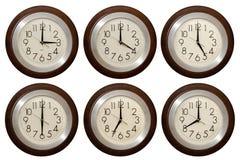 Reloj de pared aislado en el fondo blanco Fotos de archivo