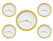 Reloj de pared amarillo Fotografía de archivo
