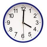 Reloj de pared azul Imágenes de archivo libres de regalías