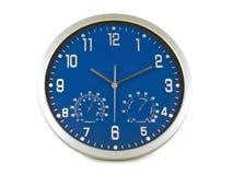 Reloj de pared azul Imagen de archivo libre de regalías
